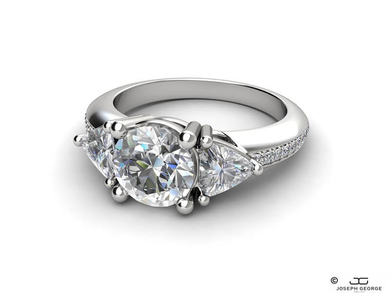 Trillion cut diamonds are the perfect match for the central round cut diamond on the Kalypso ring.